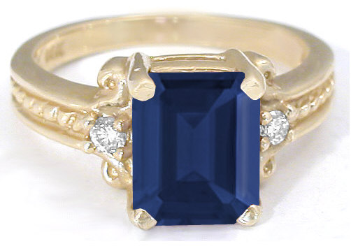 3.35 ctw Emerald Cut Sapphire and Diamond Ring in 14k yellow gold