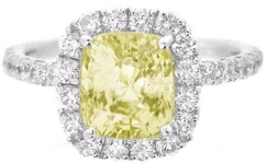 Large Cushion Cut Yellow Sapphire in Diamond Halo Setting of white gold
