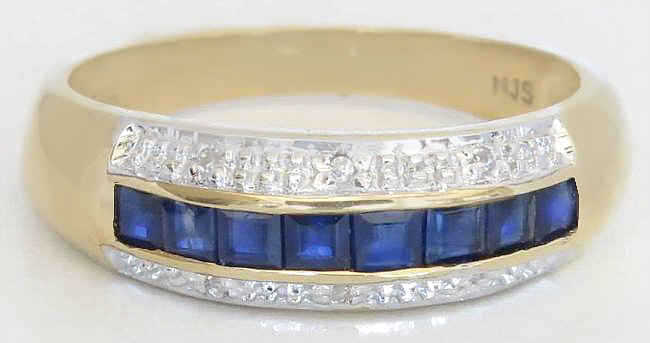 Natural Blue Sapphire Channel Set Ring with Diamond Accents in solid 14k yellow gold for sale