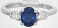 Natural oval blue sapphire and round diamond engagment ring in white gold for sale