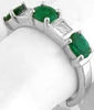 Three Stone Oval Emerald and Baguette Diamond Ring in white gold