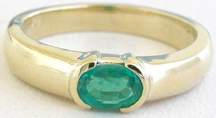 Genuine Oval Emerald Ring in 14k yellow gold - East West Set