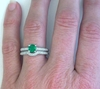 Natural Round Emerald Engagement Ring and Band on the hand