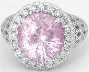 Natural Oval Light Pink Sapphire Ring with Diamond Halo in ornate white gold band for sale