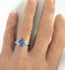 Natural Pear Blue Sapphire and Trillon White Sapphire Diamond Alternative Engagement Ring