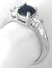 Round Blue Sapphire and White Sapphire Three Stone Ring in 14k white gold