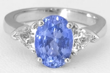 Oval Blue Sapphire and Trillion White Sapphire Three Stone Ring in 14k white gold
