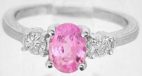 for sale: Natural Oval Pink Sapphire Engagement Ring with Round White Sapphire Sides in ornate 14k white gold band