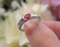 Natural East West Set Oval Ruby Solitaire Ring with Semi Bezel in solid 14k white gold