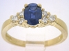 Natural Oval Rich Blue Sapphire Ring with Diamonds in solid 14k yellow gold for sale