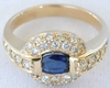 Unique East West Set Oval Natural Sapphire Ring with Real Diamond Halo in solid 14k yellow gold