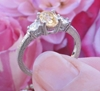 Natural Oval Light Yellow Sapphire and Round White Sapphire Engagement Ring in 14k white gold for sale