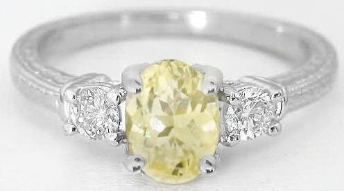 Natural Oval Light Yellow Sapphire Ring with Round White Sapphires in 14k white gold for sale