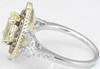 Untreated Oval Yellow Sapphire and Diamond Halo Ring in 14k white and yellow gold