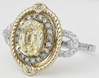 Untreated Oval Yellow Sapphire and Diamond Ring in 14k white and yellow gold